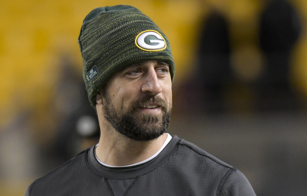 Green Bay quarterback Aaron Rodgers was medically cleared to play Tuesday night after missing eight weeks with a broken collarbone on this throwing side. He will start for the Packers against the Panthers on Sunday hoping to keep Green Bay's playoff hopes alive.
