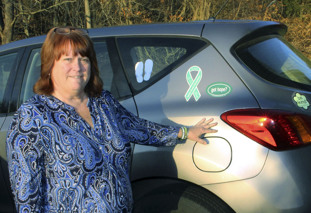 Although her car displays stickers in memory of the 26 victims of the mass shooting at Sandy Hook Elementary, Suzanne Davenport often would rather not talk about it.