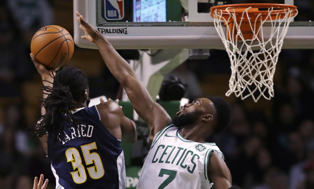 The Celtics' Jaylen Brown tries to block a shot by Denver forward Kenneth Faried in the first quarter of Wednesday night's game in Boston. Brown finished with 26 points and five rebounds.