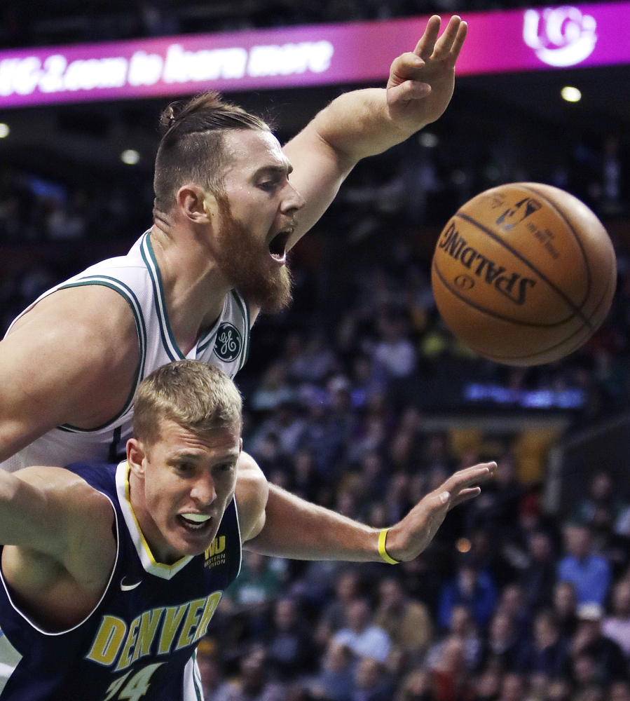 Celtics center Aron Baynes battles Nuggets center Mason Plumlee for a rebound in the first quarter.