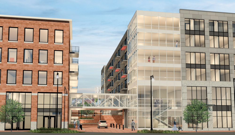 A rendering of the proposed buildings at 383 Commercial St. in Portland shows a path through the hotel and condos  development that will be open to the public.