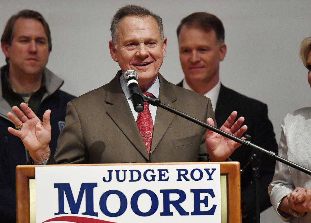 Roy Moore lost Alabama's Senate election Tuesday by 20,715 votes, but he says military and provisional ballots yet to be counted might still warrant a recount in the race for Attorney General Jeff Sessions' seat.