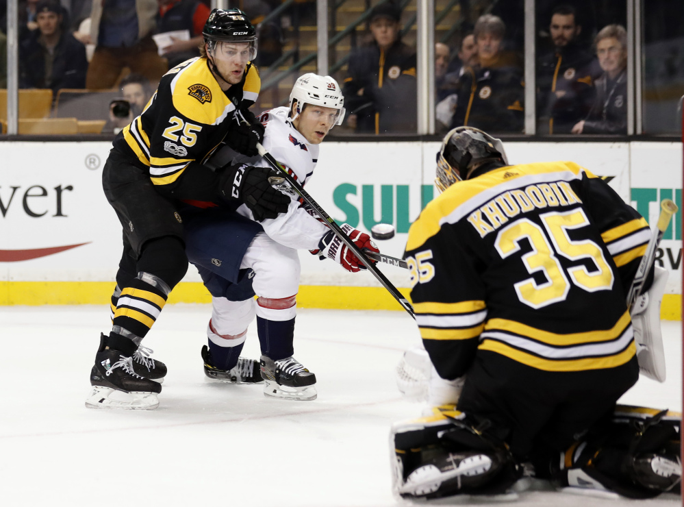Washington's Alex Chiasson watches as his shot is stopped by Bruins goalie Anton Khudobin with defenseman Brandon Carlo looking on during the first period Thursday night in Boston.