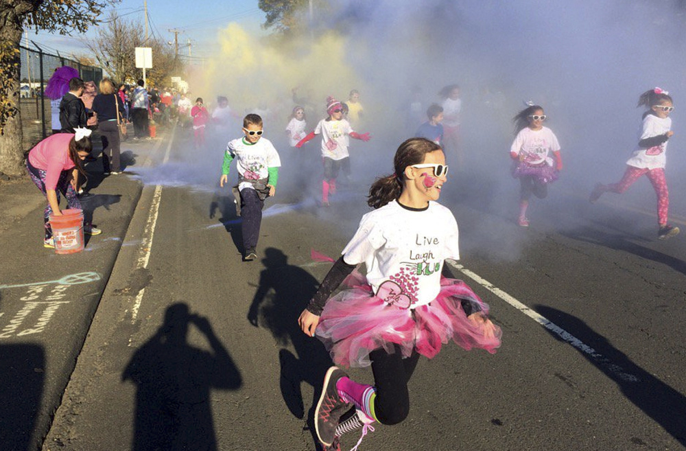 Children participate in the fun run at the Vicki Soto 5K race in Stratford, Conn., in November 2016. The race is held by the Soto family to raise money to fund scholarships.