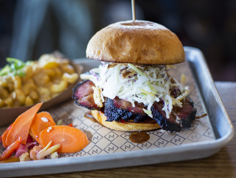 Eating Noble Barbecue's brisket sandwich is