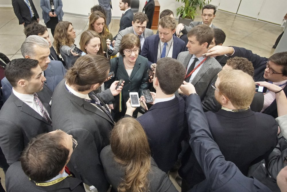 WASHINGTON, D.C. - Sen. Susan Collins is surrounded by reporters while on her way to a vote in the Senate chamber on Dec. 12.