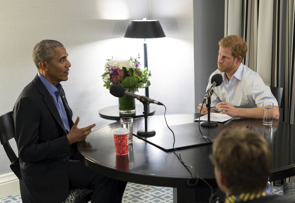 Britain's Prince Harry interviews former President Barack Obama as part of his guest editorship of BBC Radio 4's