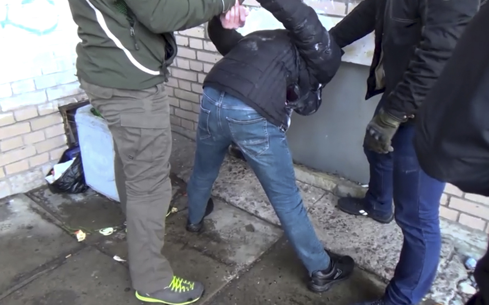 In this undated video grab provided Friday by the RU-RTR Russian television via APTN in Moscow, Russian Federal Security Service operatives detain a suspected member of the Islamic State group's cell in St. Petersburg, Russia.