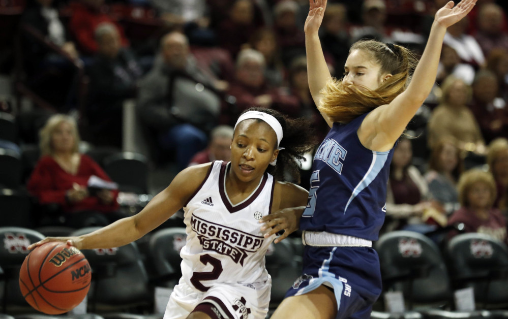Morgan William, who sank the buzzer-beating basket in last season's NCAA semifinal that ended Connecticut's 111-game winning streak, drives against Maine's Dor Saar during Mississippi State's 83-43 victory Sunday.