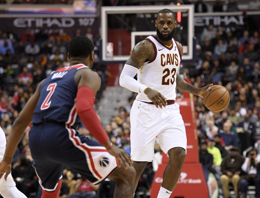 Wizards guard John Wall tries to defend Cleveland's LeBron James during the Cavs' 106-99 win Sunday in Washington. James finished with 20 points, 12 rebounds and 15 assists.