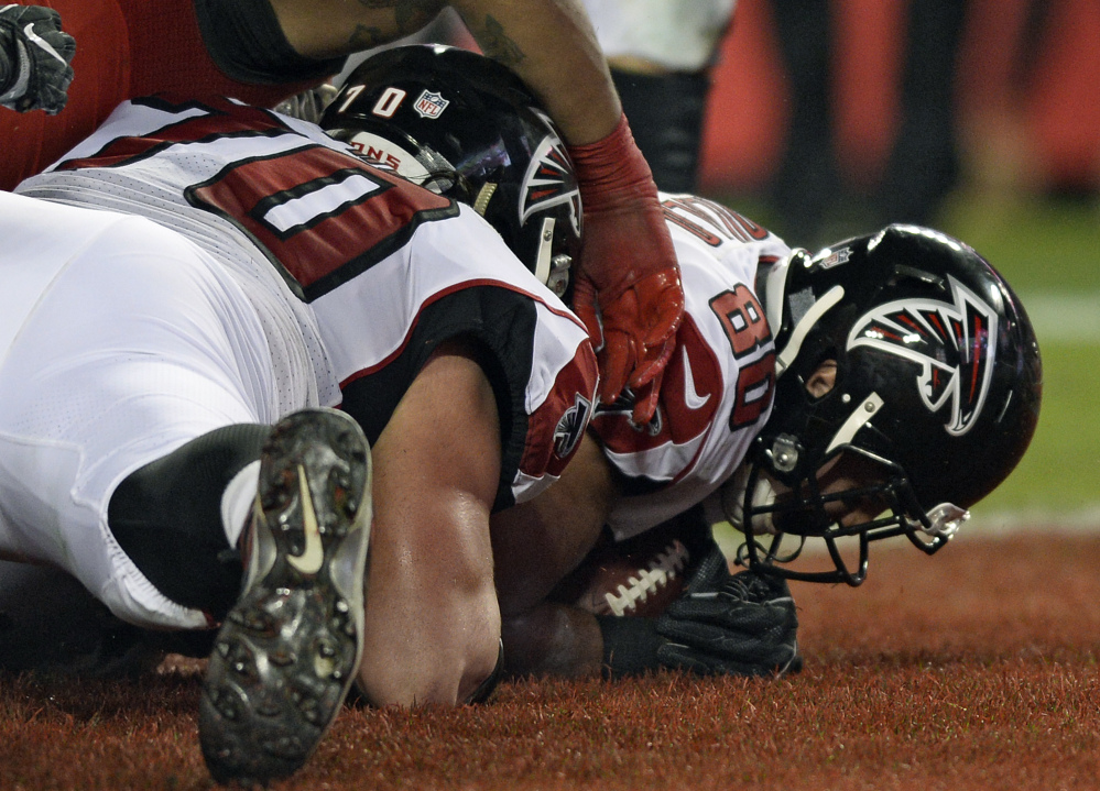 Falcons tight end Levine Toilolo falls on a fumble by running back Devonta Freeman for a touchdown Monday night against the Tampa Bay Buccaneers.