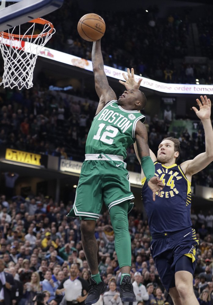 Terry Rozier goes up for the game-winning dunk against Indiana after making a steal and breaking away. Boston won, 112-111.