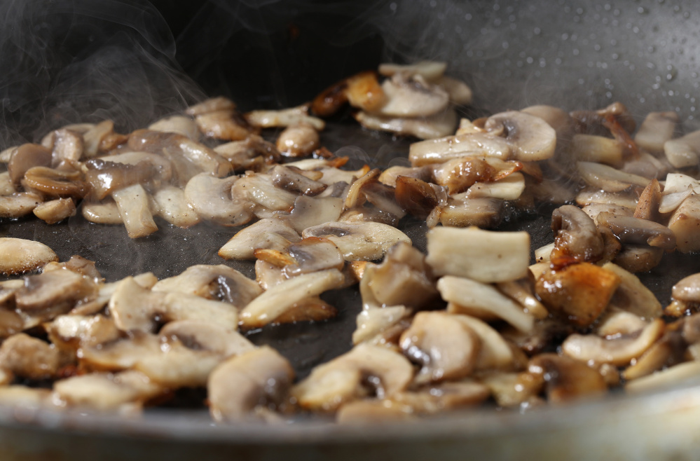 Once you add the 'shrooms to the pan, don't touch them until they begin to brown. Photos by Abel Uribe/Tribune News Service