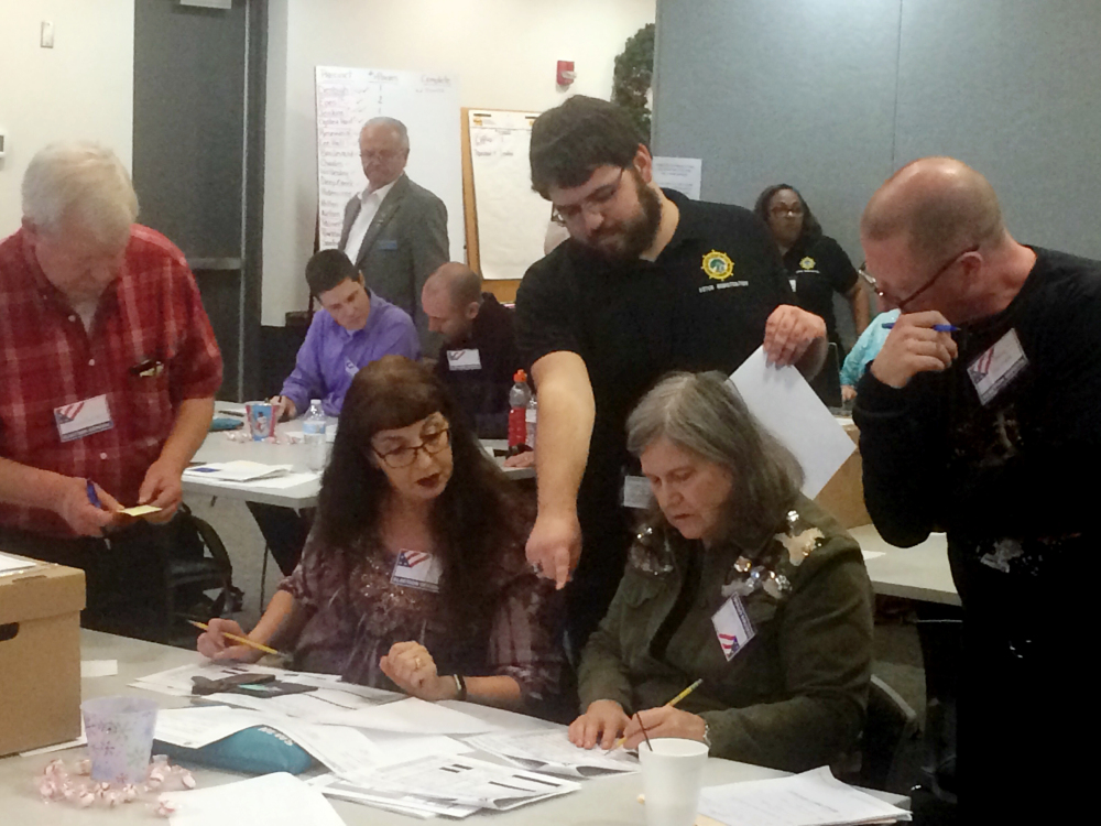 Election officials in Newport News, Va., examine ballots that a computer failed to scan during a recount for a House of Delegates race on Tuesday. Republican incumbent Del. As of today the race is tied.
