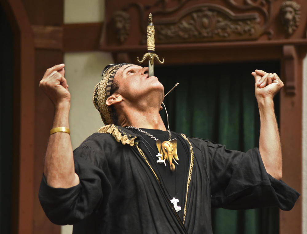 Johnny Fox performs last year at the Renaissance Festival in Crownsville, Md. He died of cancer at 64, surrounded by loved ones who gave him a standing ovation.