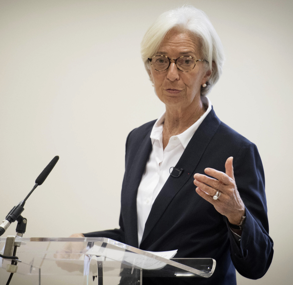 International Monetary Fund Managing Director Christine Lagarde speaks to the media Wednesday after the IMF lowered its 2017 growth forecast for the British economy.