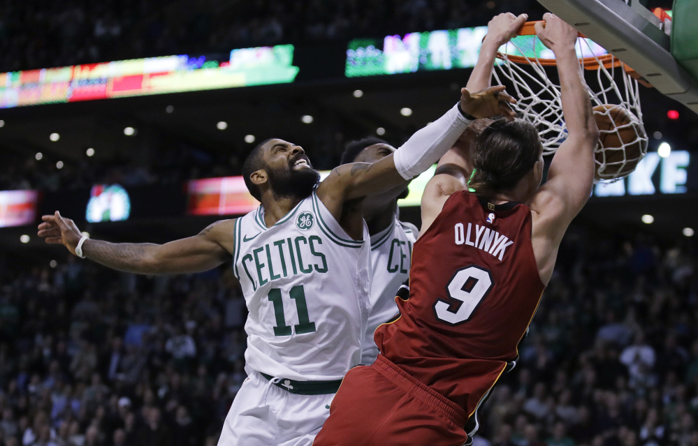 Miami Heat center Kelly Olynyk, a Celtic until this year, beats Celtics guard Kyrie Irving to the basket for a dunk in the second half of Miami's one-point win in Boston on Wednesday night. Olynyk scored a career-high 32 points in the game.