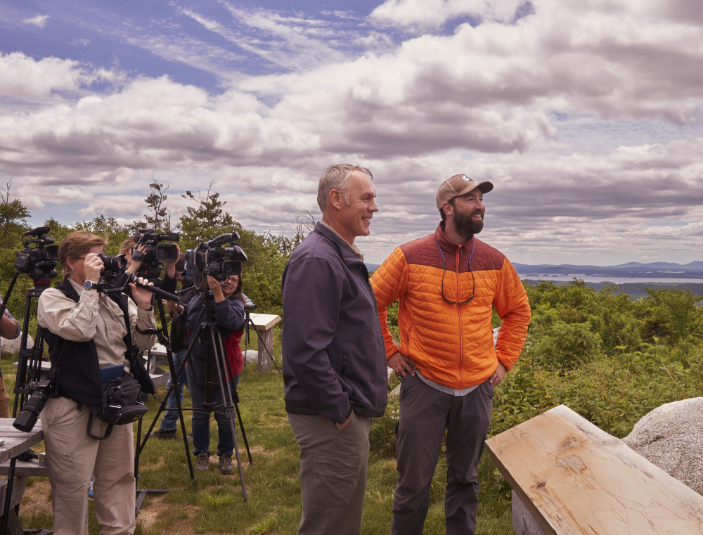 Interior Secretary Ryan Zinke, left, and Lucas St. Clair look out over the Katahdin Woods & Waters National Monument in June. The new park survived a federal review of monuments nationwide considered for possible downsizing or expanded logging.