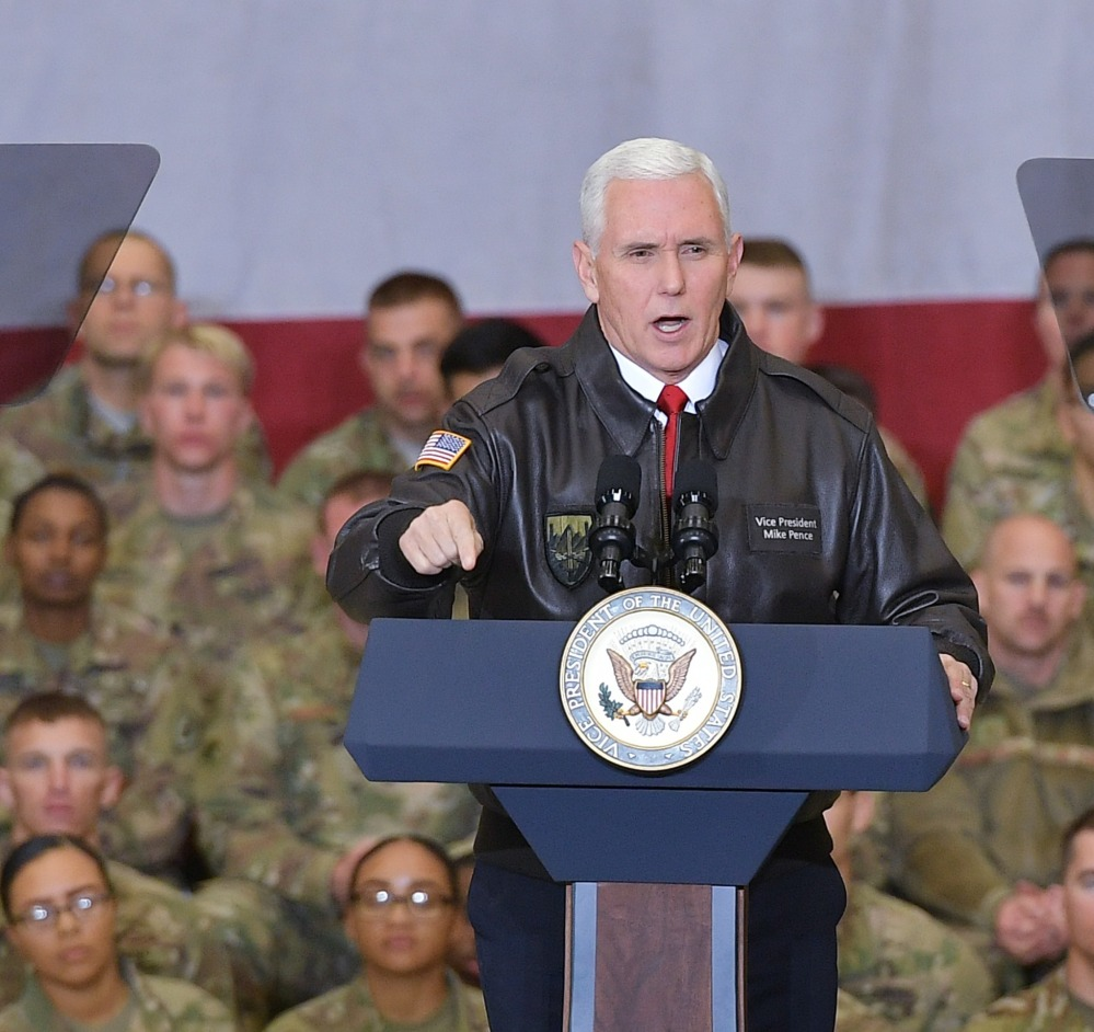 U.S. Vice President Mike Pence speaks to troops in a hangar at Bagram Air Base in Afghanistan on Thursday.