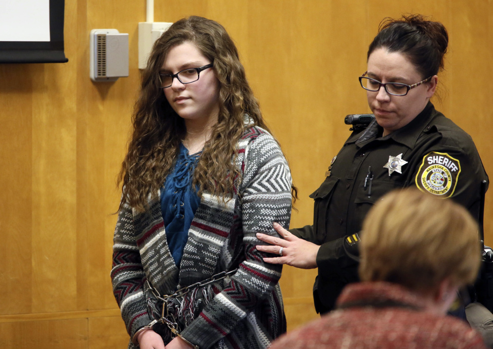 Anissa Weier, one of two Wisconsin girls who tried to kill a classmate to win favor with a fictional character, is led into the Waukesha County Court for her sentencing Thursday.