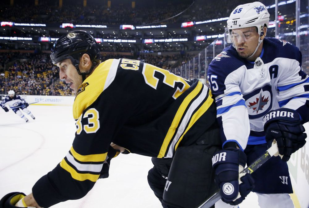Boston's Zdeno Chara and Winnipeg's Mark Scheifele battle along the boards in the first period Thursday night in Boston.