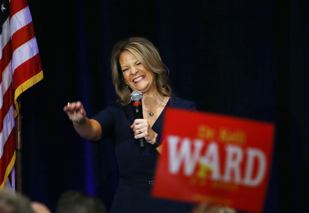 Former Republican Arizona state Sen. Kelli Ward is greeted by supporters at a campaign fundraiser, in Scottsdale, Ariz. Some Republican Party leaders warn that conservative candidates with problematic track records like Danny Tarkanian In Nevada or Ward can't win general election battles and will lead the party to lose seats in 2018.