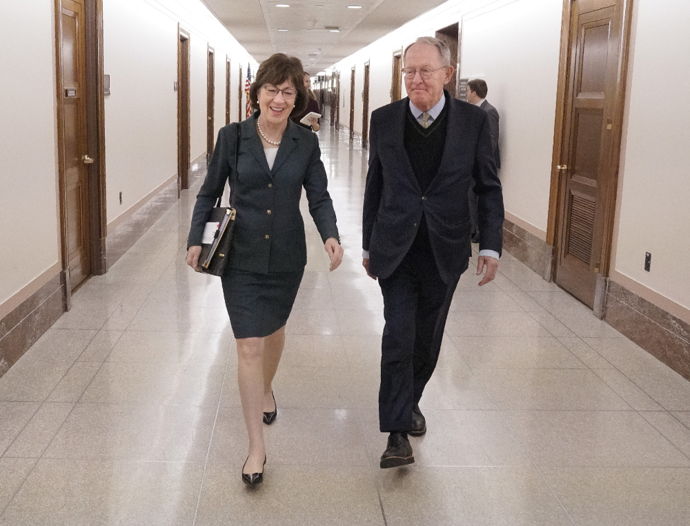 Sen. Susan Collins with Sen. Lamar Alexander, R-Tenn., at the Dirksen Office Building on Capitol Hill on Dec. 12. Both have advocated for bills that would help stabilize health insurance markets under the Affordable Care Act. Collins had hoped her colleagues would vote on the measures by year's end. That didn't happen, but she expects them to be taken up next month.
