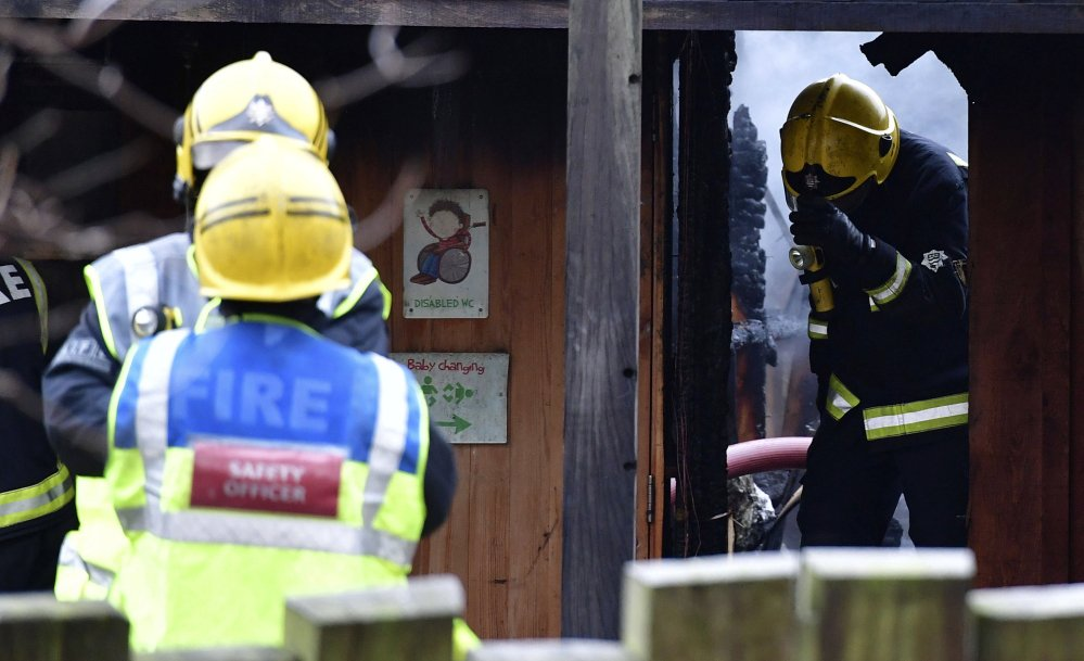 Firefighters work at the London Zoo on Saturday after a fire broke out near the cafe in the early morning.