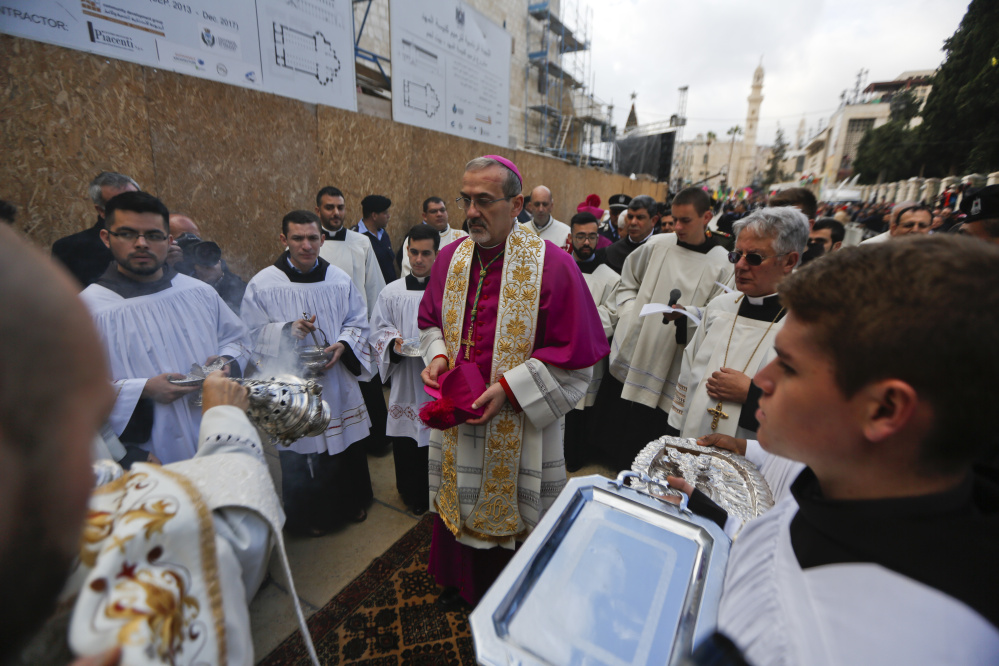 The Latin Patriarch of Jerusalem Pierbattista Pizzaballa arrives Sunday at the Church of the Nativity, built atop the site where Christians believe Jesus Christ was born in the West Bank city of Bethlehem.