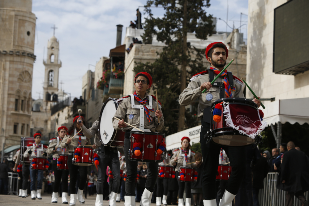 Members of a Palestinian marching band parade during Christmas celebrations outside the Church of the Nativity in Bethlehem on Sunday.