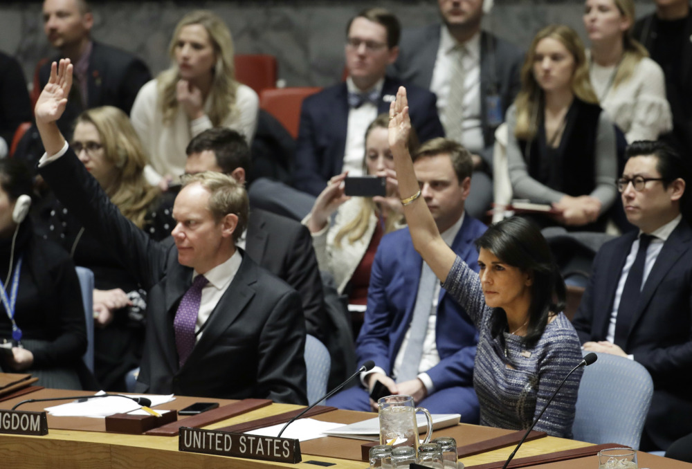 Matthew Rycroft, left, Britain's ambassador to the U.N., and U.S. Ambassador Nikki Haley vote in favor of a resolution Friday at United Nations headquarters. The council was voting on proposed new sanctions against North Korea, including sharply lower limits on its refined oil imports, the return home of all North Koreans working overseas, and a crackdown on the country's shipping.