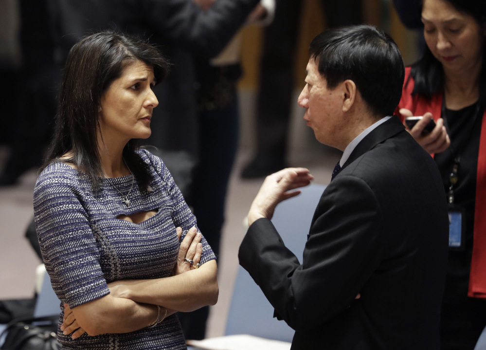 U.S. Ambassador to the United Nations Nikki Haley talks with Chinese deputy ambassador Wu Haitao on Friday at United Nations headquarters. The council was voting on proposed new sanctions against North Korea, including sharply lower limits on its refined oil imports, the return home of all North Koreans working overseas, and a crackdown on the country's shipping.