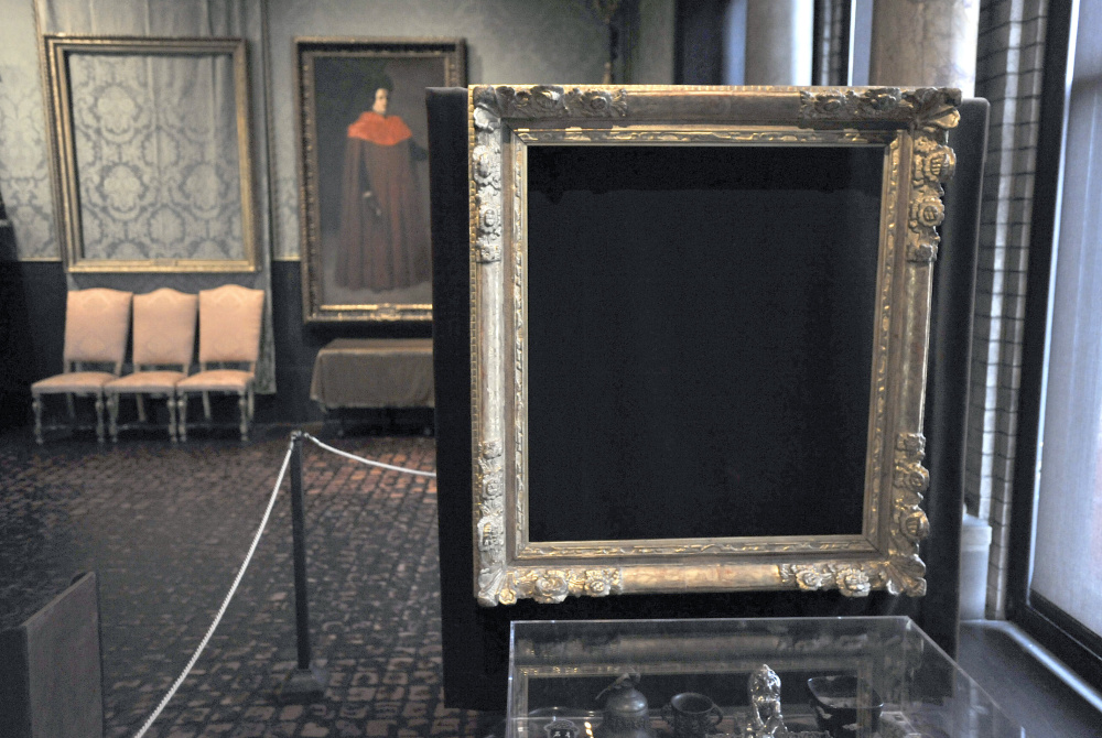 "Empty frames mark where Rembrandt's ""Christ in the Storm on the Sea of Galilee"", left, and Vermeer's ""The Concert"" were stolen from Boston's Isabella Stewart Gardner Museum."