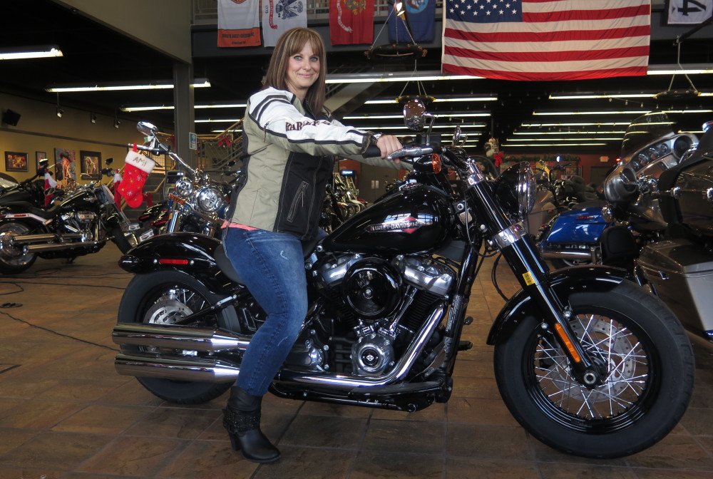 Terri Meehan, 42, with a 2018 Harley-Davidson Softail Slim at a House of Harley store in Milwaukee, Wis. Meehan took a riding course this fall through the company's Riding Academy. The motorcycle giant is working to expand the ranks of female riders from the current 14 percent.
