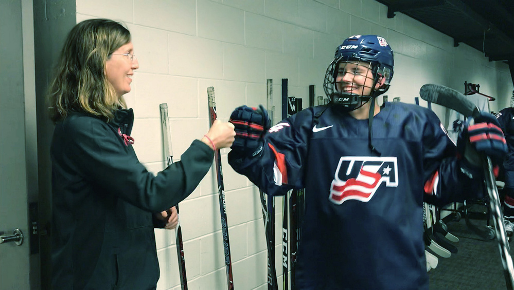 Dr. Allyson Howe, team doctor for the U.S. Women's Olympic Hockey Team, fist bumps player Dani Cameranesi of Minnesota before a recent game in San Jose, Calif.