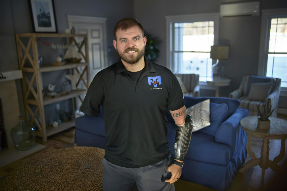 Veteran Travis Mills, who lost all four limbs in an IED explosion in Afghanistan, opened a camp retreat for veterans and their families.