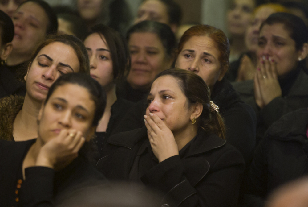 Relatives of Coptic Christians grieve during a funeral service for victims of the attack on a church in Cairo on Friday. At least nine people, including eight Coptic Christians, were killed when an unidentified gunmen opened fire outside the church.