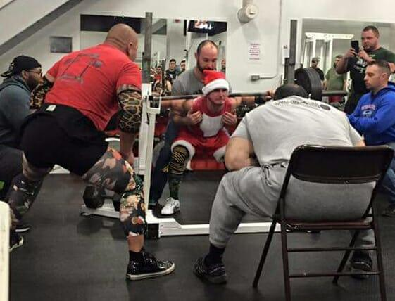 A lifter dressed as Santa Claus executes a squat lift at last year's Squat for Tots, a powerlifting competition benefiting the Toys for Tots Foundation at Black Bridge Crossfit in Brunswick.