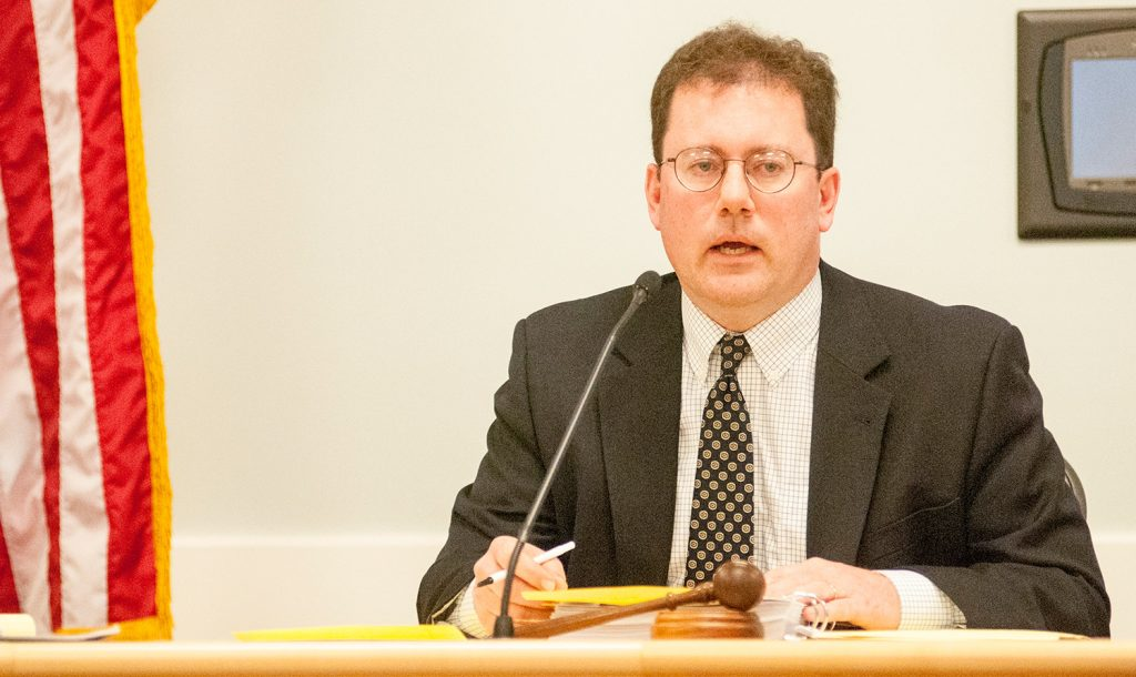 Maine Public Utilities Commission Chairman Mark Vannoy presides Tuesday in Hallowell. The regulators established a tight time frame for post-mortems on the late-October storm.