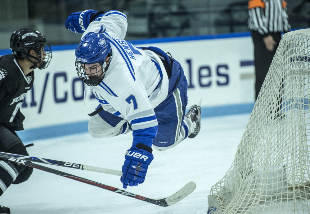 WATERVILLE, ME - DECEMBER 1, 2017   Colby College's Spencer Hewson (7) flies through the air as he is tripped by Bowdoin College;s Jason Cahoon (9) at Alfond Ice Arena at Colby College in Waterville on Friday, Dec. 1, 2017. (Staff photo by Michael G. Seamans/Staff Photographer)