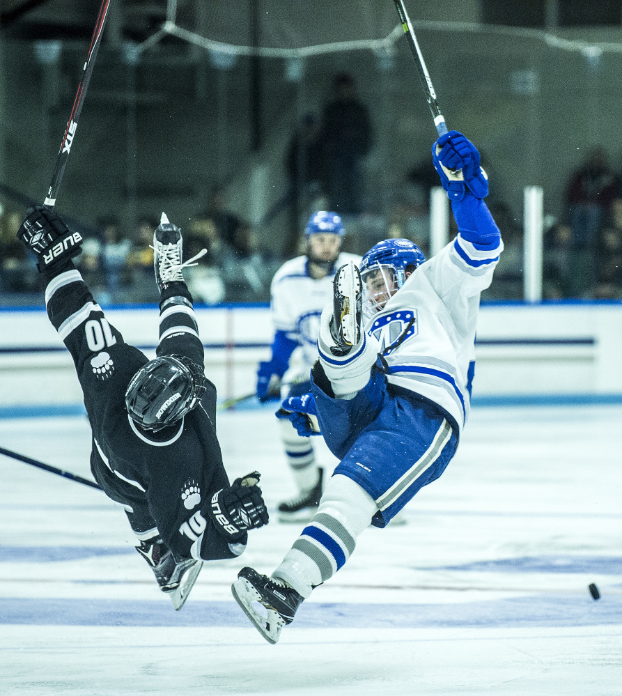 WATERVILLE, ME - DECEMBER 1, 2017   Colby College's JP Schulen (26) collides with Bowdoin College's Ronnie Lesten (10) at Alfond Ice Arena at Colby College in Waterville on Friday, Dec. 1, 2017. (Staff photo by Michael G. Seamans/Staff Photographer)