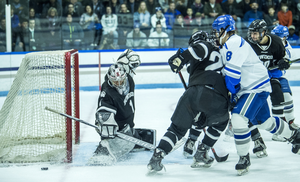 WATERVILLE, ME - DECEMBER 1, 2017   Bowdoin College goalie Alex Zafonte (1) makes a save as Colby College's Justin Grillo (8) looks for the rebound at Alfond Ice Arena at Colby College in Waterville on Friday, Dec. 1, 2017. (Staff photo by Michael G. Seamans/Staff Photographer)