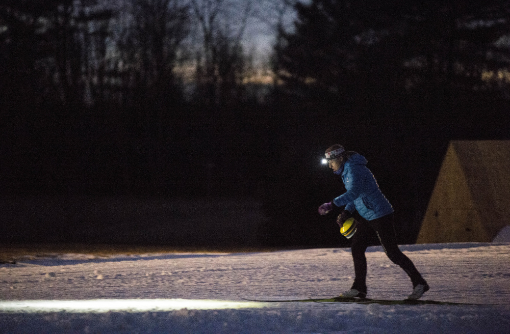 A member of the Colby College ski team enjoys early season Nordic skiing at Quarry Road Trails on Thursday.