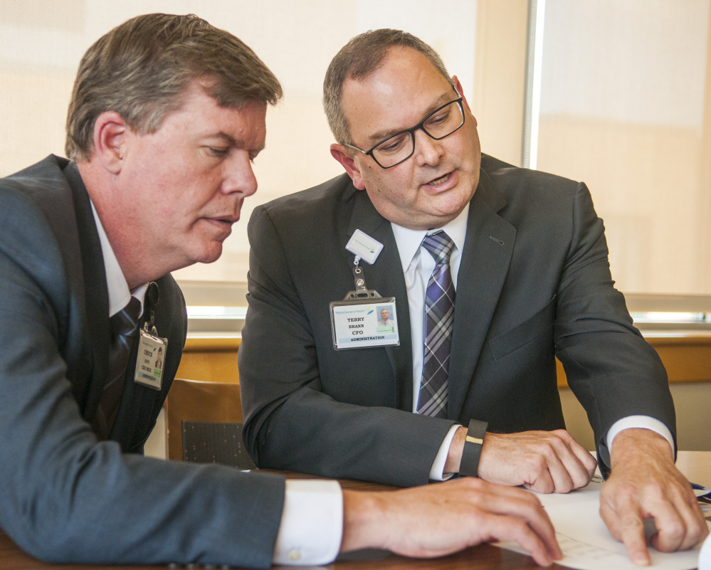 "Chuck Hays, left, president and chief executive officer of MaineGeneral Medical Center in Augusta, says the hospital system has ""a good plan"" for the year ahead in addressing complaints from primary care physicians that has resulted in operating losses and a credit downgrade. The hospital's chief financial officer, Terry Brann, right, says he expects the losses in the first half of this year — $2.9 million — can be made up for in the second half, which is typically a busier time of year."