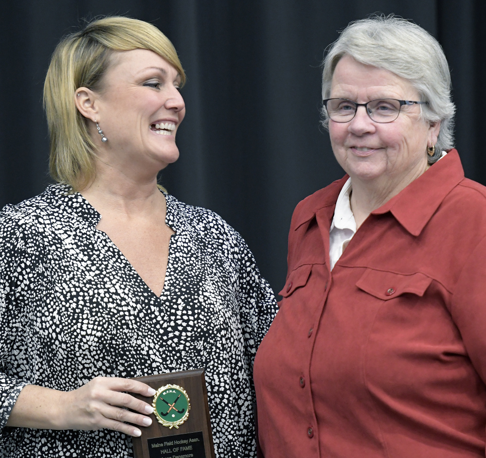 Lesa Densmore, left, poses with Moe McNally, her former Gardiner field hockey coach during the annual Maine Field Hockey Association banquet Sunday at the Augusta Civic Center. Densmore was inducted into the association's Hall of Fame.