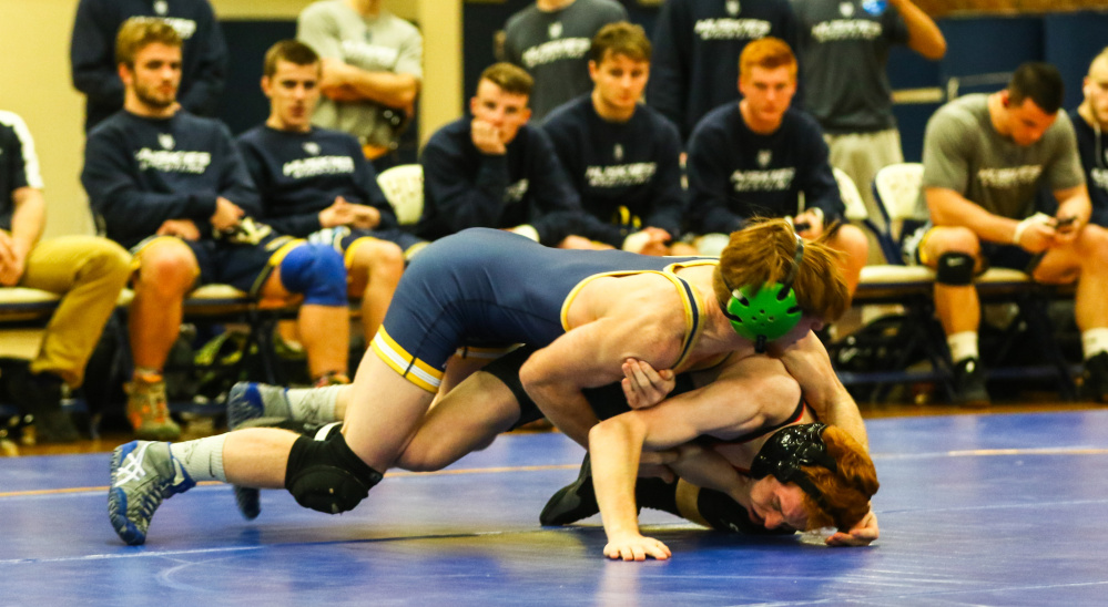 Contributed photo/USM athletics   University of Southern Maine sophomore Peter Del Gallo, top, pins down Shawn Ferrell of Bridgewater State during a 125-pound match at the Costello Sports Complex in Gorham. Del Gallo pinned Ferrell in 48 seconds.