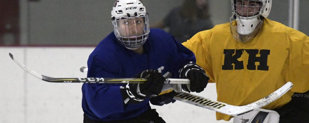Cam Wilson, left, skates in front of the net Tuesday during hockey practice at Kents Hill School in Readfield.