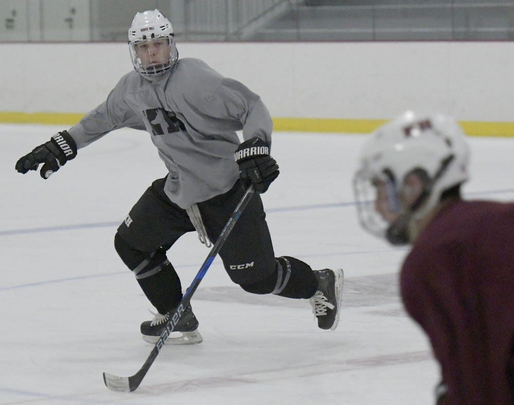 Jackson Aldrich, left, on the ice Tuesday during hockey practice at Kents Hill School in Readfield.