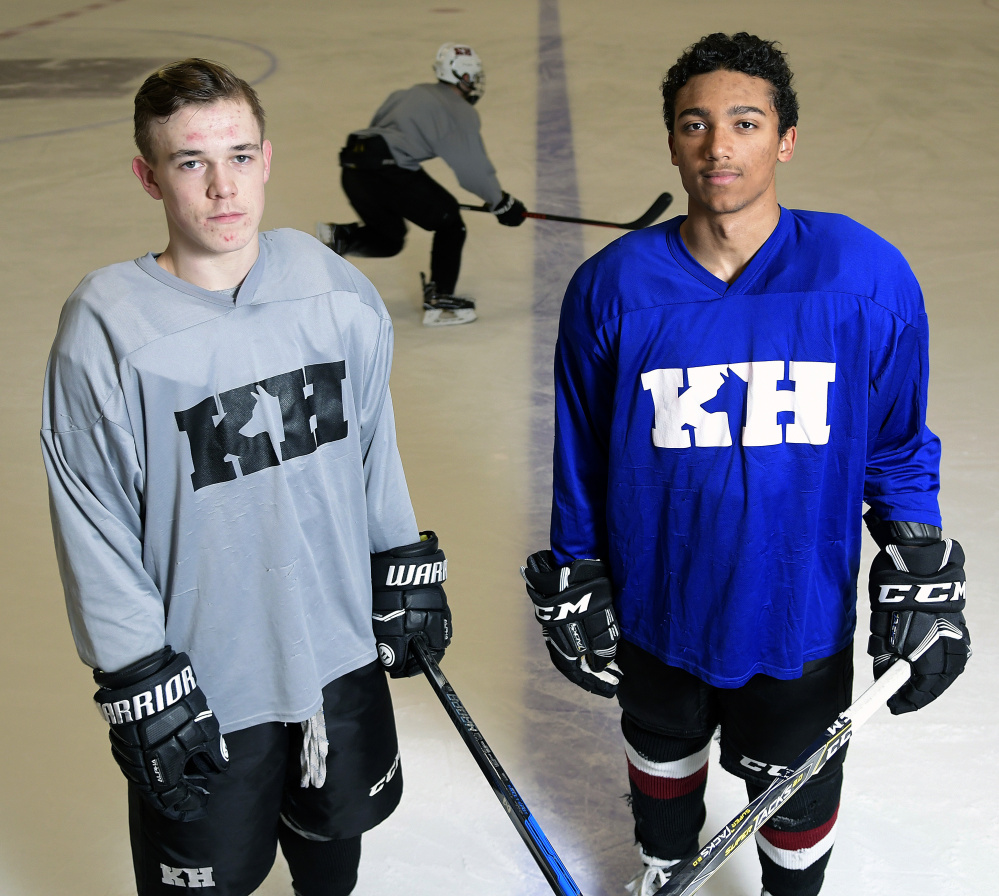 Jackson Aldrich, left, and Cam Wilson stand on the ice Tuesday during practice at Kents Hill School in Readfield.