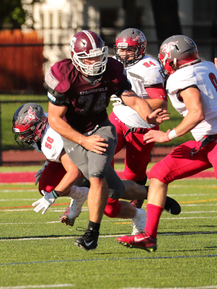 Chris Hayden was never an offensive lineman until last year. This season, the Madison graduate was one of leader's of a Springfield College line that led all of Division III football in rushing.